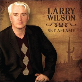 SET AFLAME - Larry Wilson