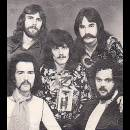 1974 Sunday Funnies - managers Bob Fox_ Ron Aitken Koz (Richard Kosinski) organ'vocals - me Rosco drums sitting Richard Fidge lead singer and Ron Aitken bass_vocals and Gary Quackenbush (SRC) lead guitar-